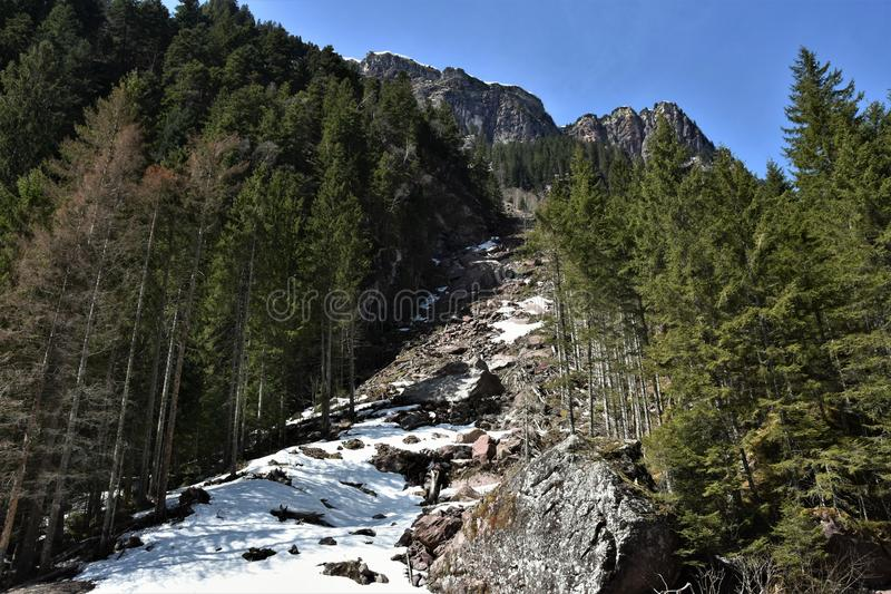 Steep rocky slope near by tourist path heading directly towards to Murg lakes stock images