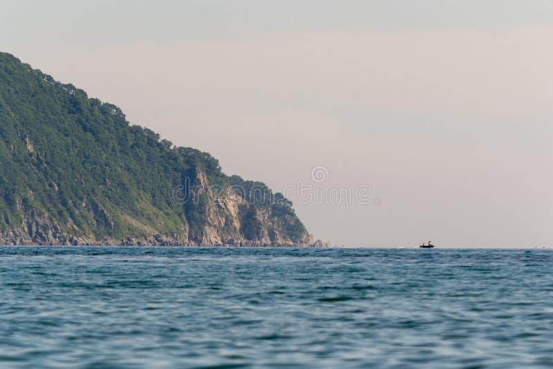 A steep, rocky slope on the seashore. stock image