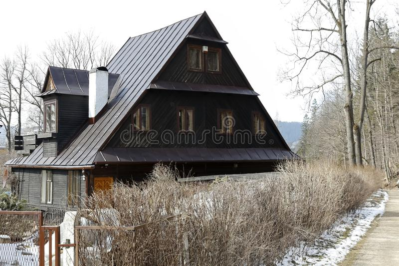 The steep roof of the wooden house royalty free stock images