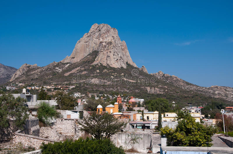 Steep sided monolith. Pena de Bernal, one of the world's largest monoliths and a site of pilgrimage in San Sebastian Bernal, Mexico royalty free stock images