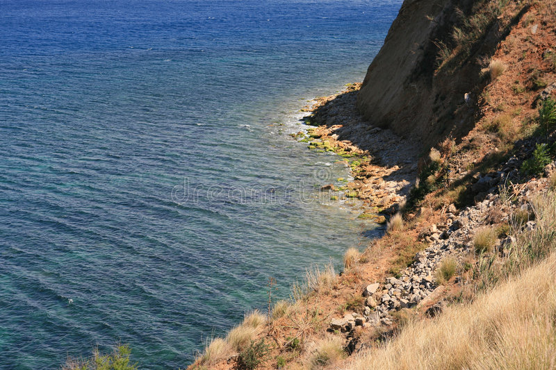 Steep Slope On Mediterranean Coast Royalty Free Stock Photo