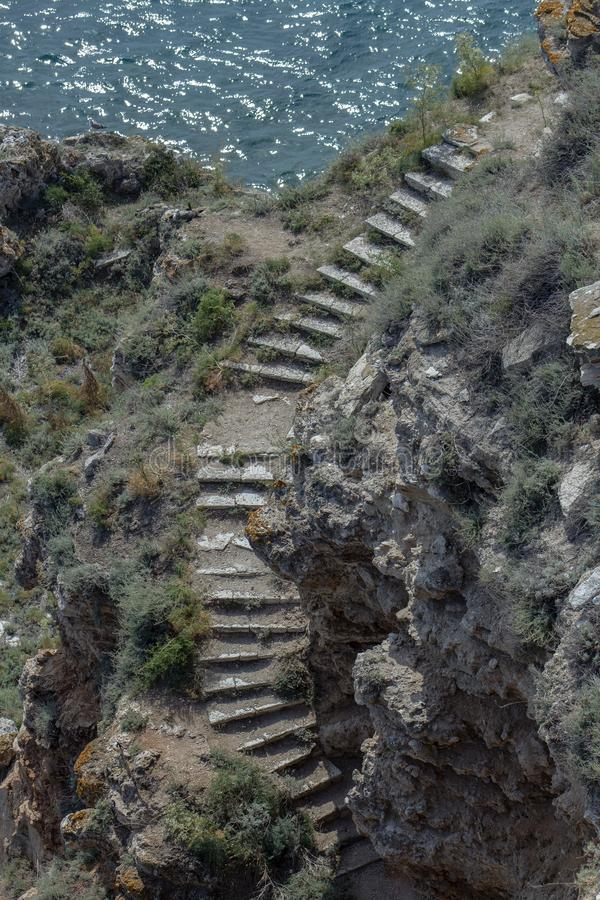 Steep stairs to the water. Seascape from Cape Kaliakra. North Black Sea coast. Bulgaria. stock photos