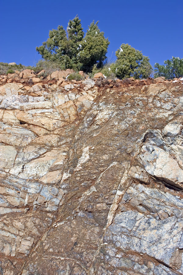 Free Steep Stone Face On Mountain In Spain With Tree On Top Royalty Free Stock Photography - 575717