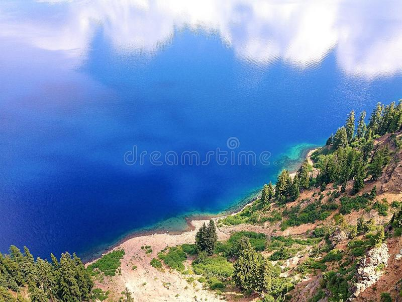 Steep View of Wind Blown Clear Blue Lake stock photography