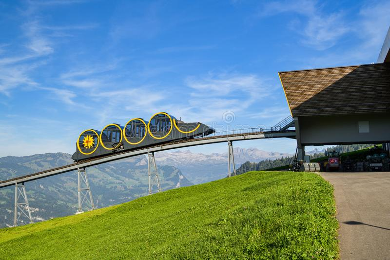 Steepest funicular of the world approaching top station in village of Stoos, Switzerland. Stoos, Switzerland - September 20, 2019: Steepest funicular of the stock photos