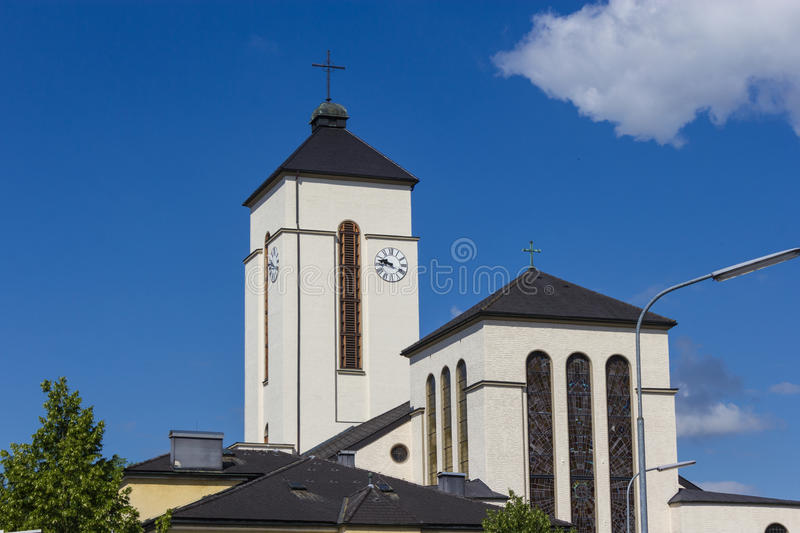 The steeple of the holy ghost church in Attnang-Puchheim stock photo