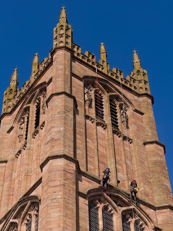Steeplejacks Working on Church Tower royalty free stock image