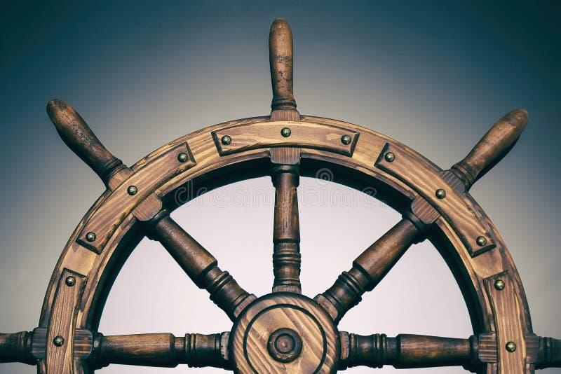 Steering hand wheel ship on black background royalty free stock photo