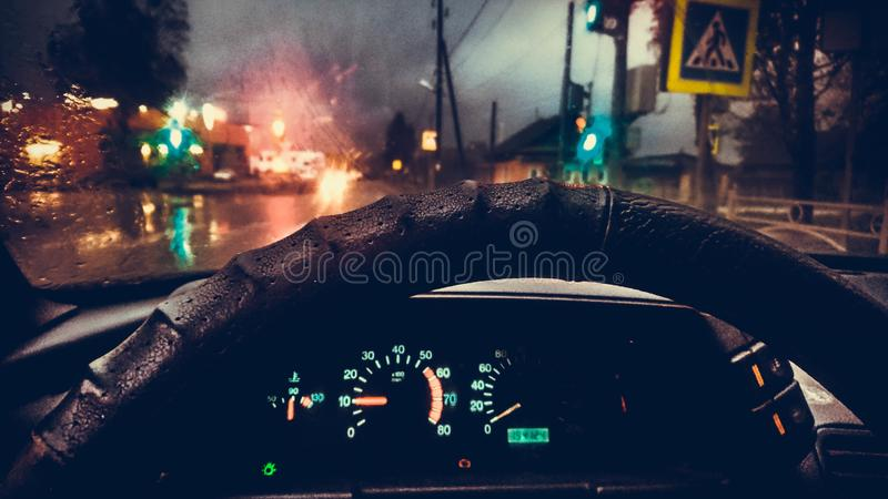 Steering wheel in the cabin on the street background. Control panel transport color signs stock photos
