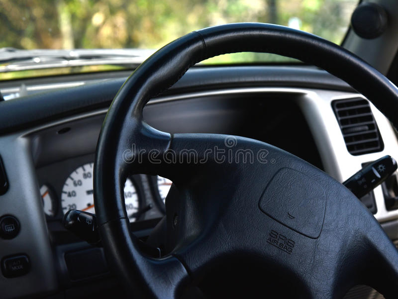 Steering wheel Car - Car interior. Car interior - steering wheel Car - Car interior Car interior and controls of car stock photography