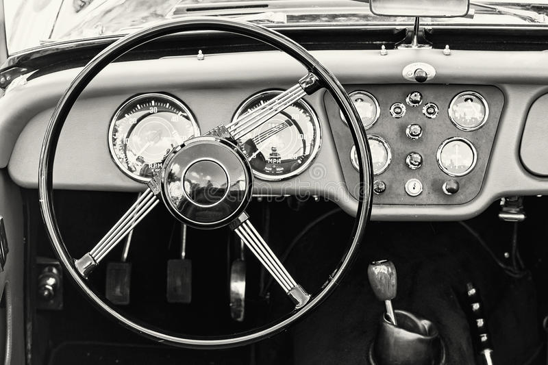 steering wheel and dashboard in historic vintage car black and stock photo image 77071281. Black Bedroom Furniture Sets. Home Design Ideas