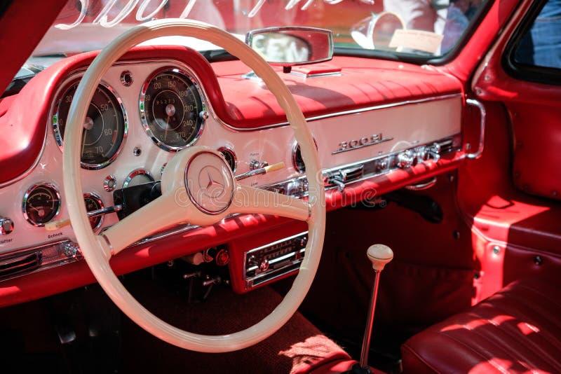 Steering wheel, dashboard and interior of beautiful vintage car. Berlin, Germany - june 09, 2018: Steering wheel, dashboard and interior of beautiful vintage car stock image