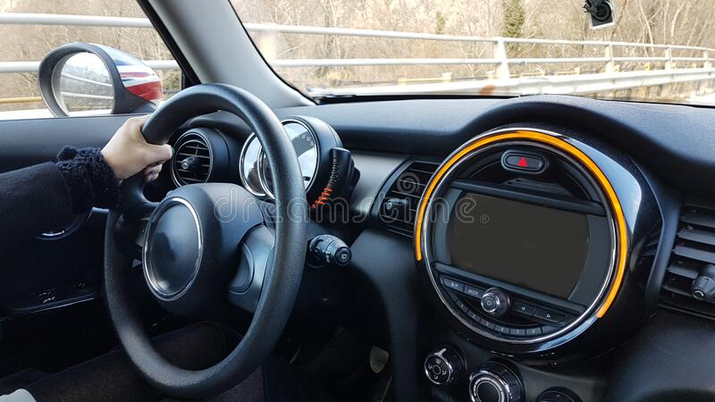 Steering wheel drivers hands and modern black car royalty free stock photo