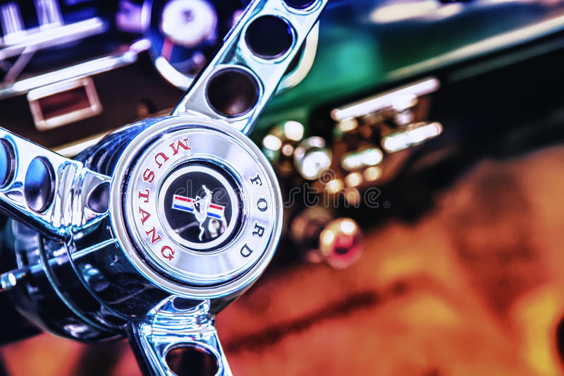 Steering wheel of Ford Mustang stock images