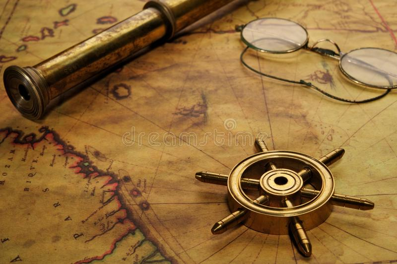 Steering wheel, glasses and spyglass royalty free stock image