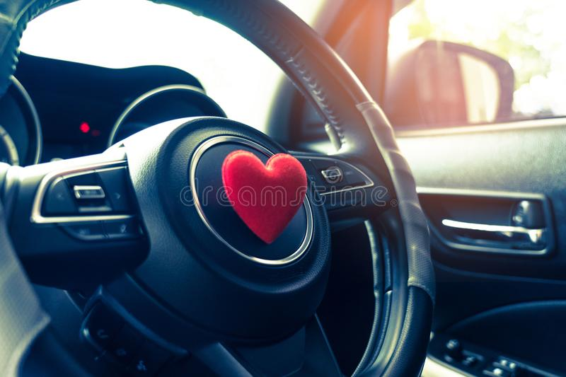 Steering wheel with heart red object.Love car concept idea.interior console car. royalty free stock photography