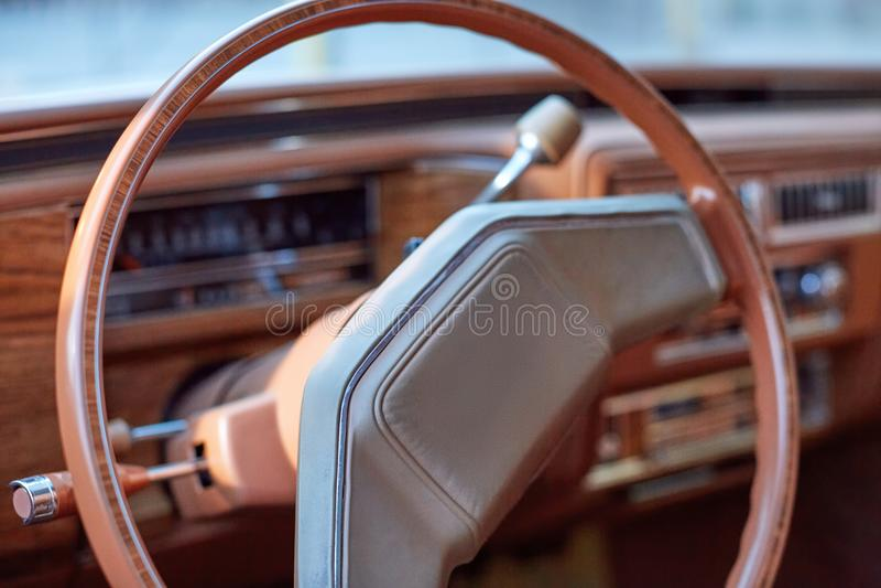 Steering wheel inside a vintage car stock image