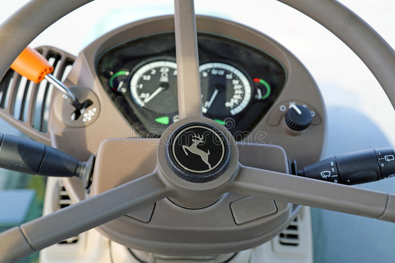Steering Wheel of John Deere Agricultural Tractor royalty free stock photos