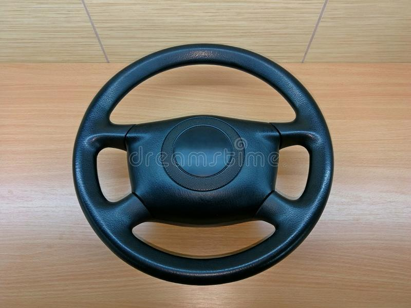 Steering wheel plastic black, removed from the car and placed on the desk near the lining royalty free stock photos
