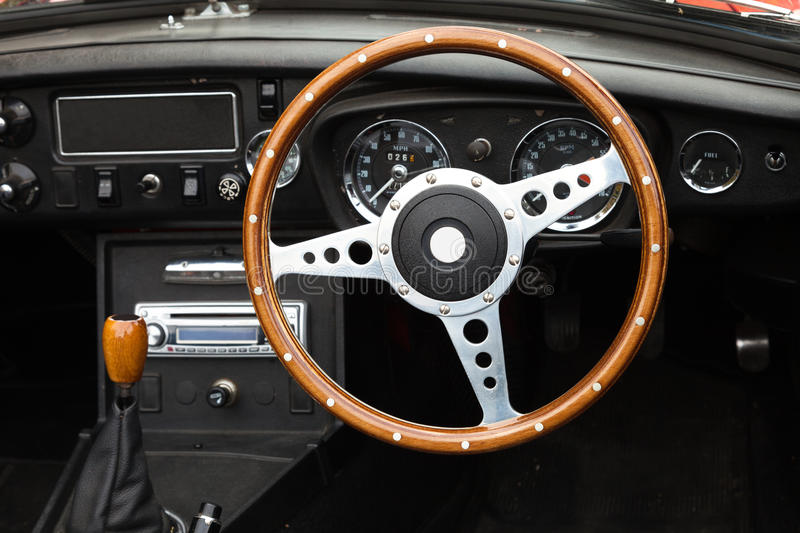 Steering Wheel. Wooden steering wheel from a MGB roadster sports car stock photos