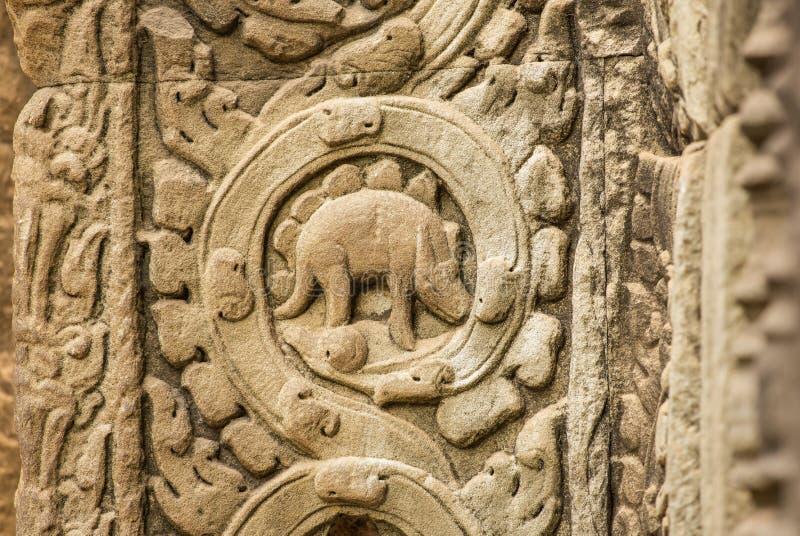 Stegosaurusflachrelief auf der Wand von Tempel Ta Prohm lizenzfreies stockbild