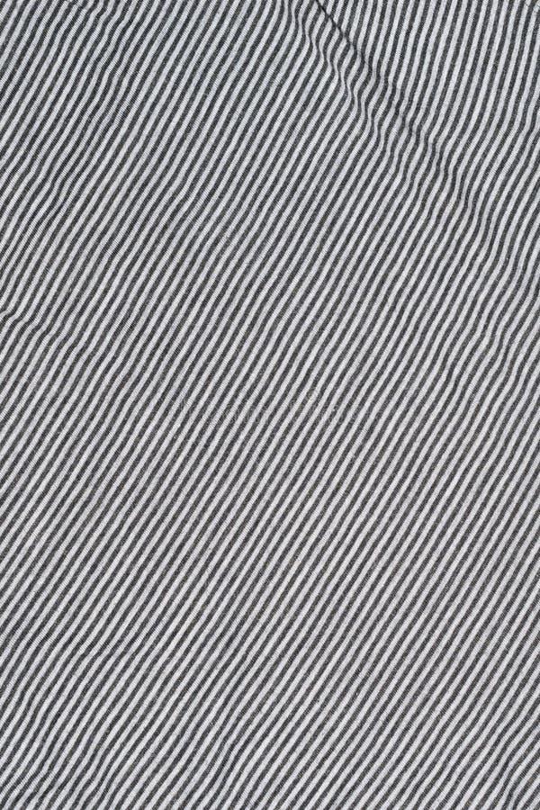 Stegvis vit väv med grå remsor arkivfoton