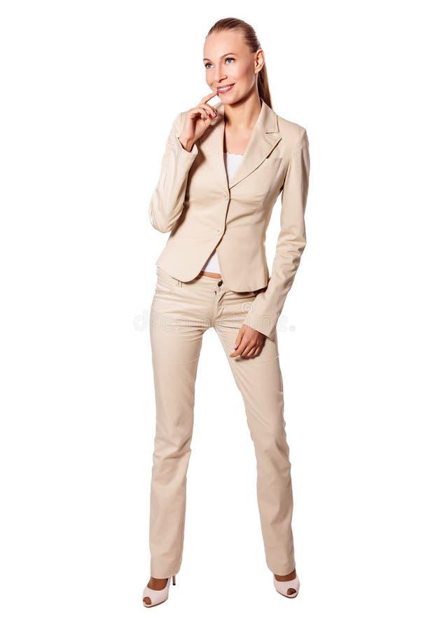 Stehende ernste Geschäftsfrau stockbilder