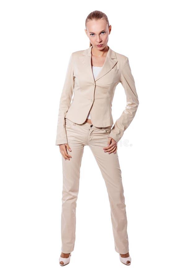 Stehende ernste Geschäftsfrau stockfotografie