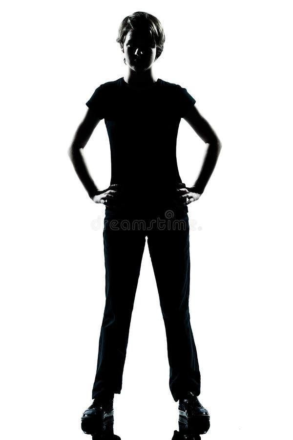 Stehende Hände des Schattenbildes mit einen jungen Jugendlichjungen oder -mädchenauf Hüften stockfoto