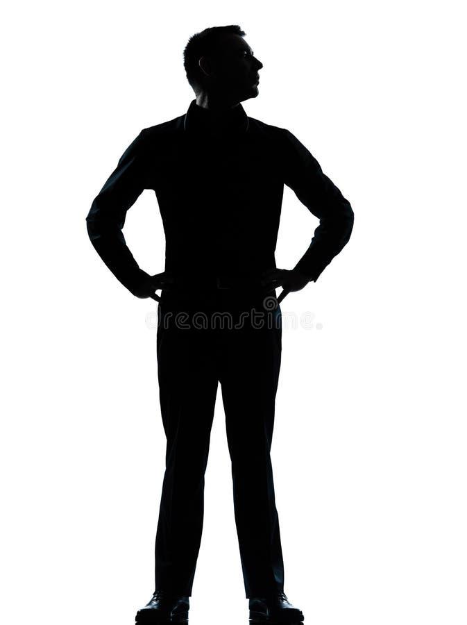 Stehende Hände von einem Geschäftsmann auf Hüfteschattenbild stockbilder