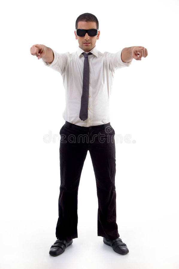 Stehender Berufsmann, der mit beiden Händen zeigt stockbilder