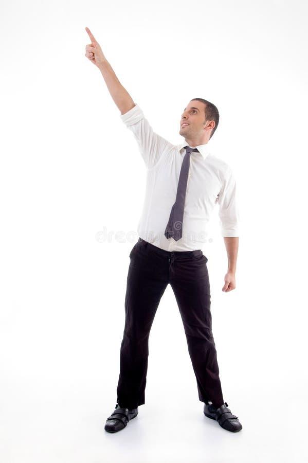 Stehender Berufsmann, der oben zeigt stockfoto