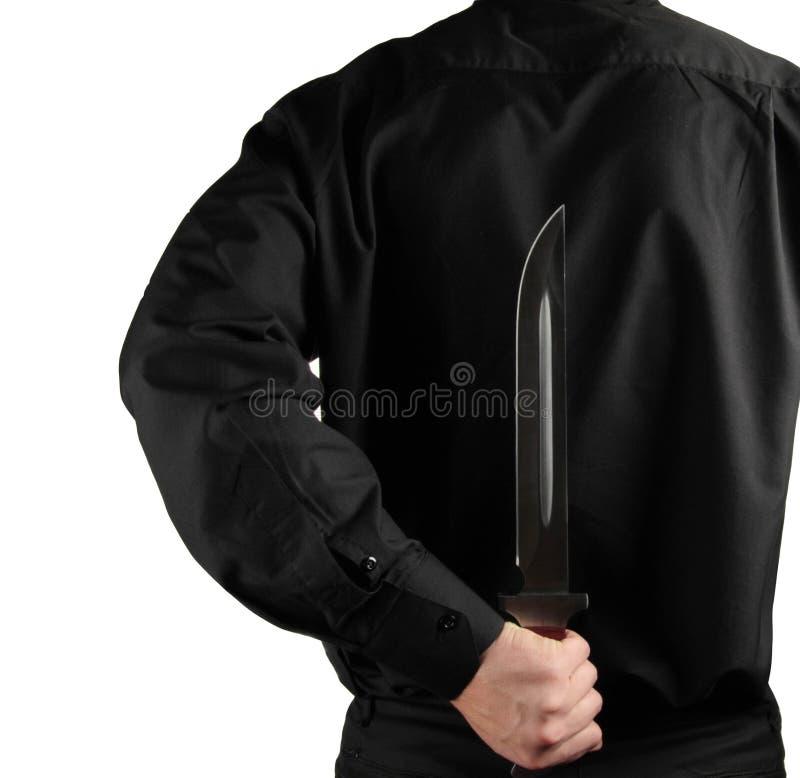 Stehender Mann im Schwarzen mit Messer für Rückseiten lizenzfreie stockfotos