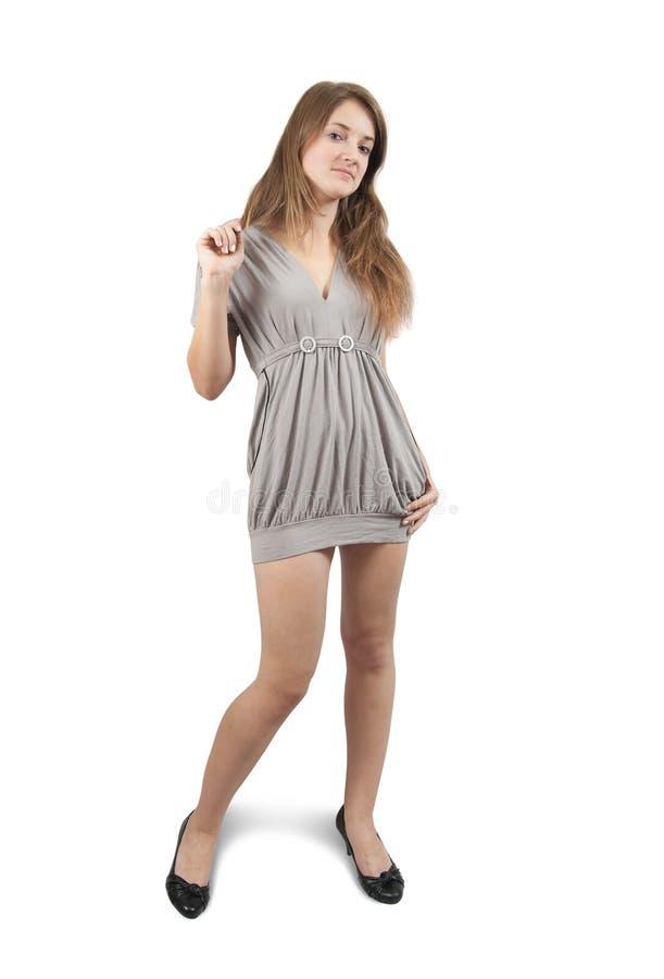 Stehendes Mädchen im grauen Kleid lizenzfreies stockbild