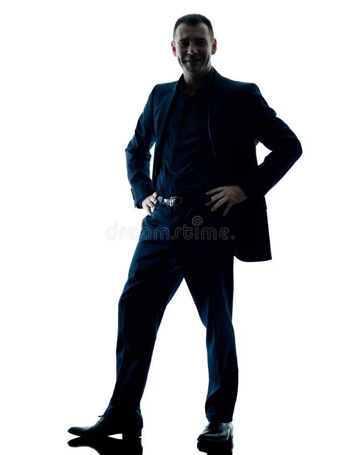 Stehendes Schattenbild des Geschäftsmannes lokalisiert stockfoto