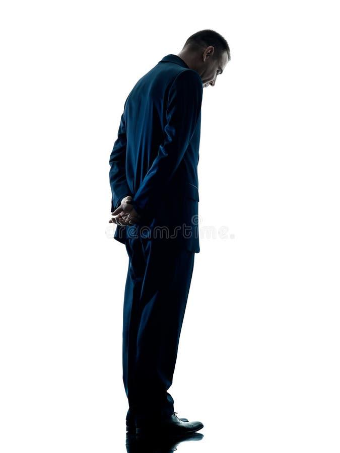 Stehendes Traurigkeitsschattenbild des Geschäftsmannes lokalisiert stockfoto