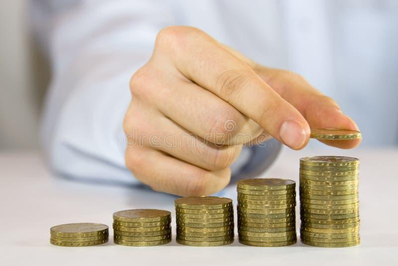 Steigende Münzen lizenzfreies stockbild