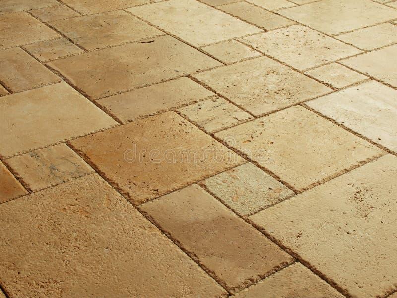 Stein deckte Fußboden mit Ziegeln stockfotografie