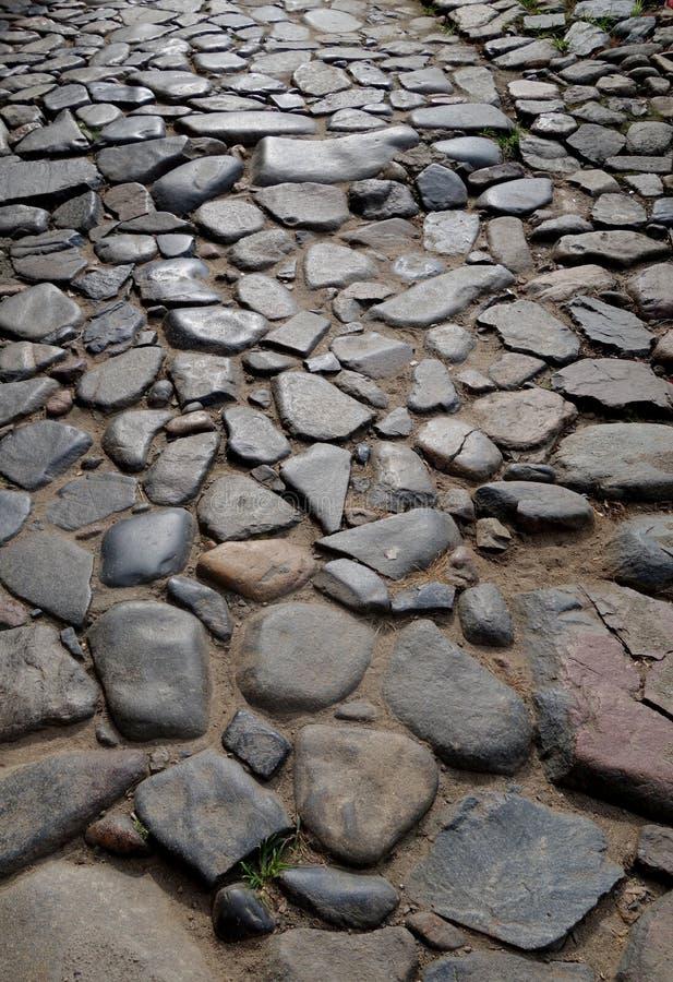 Stein gepflasterte Straße stockbilder