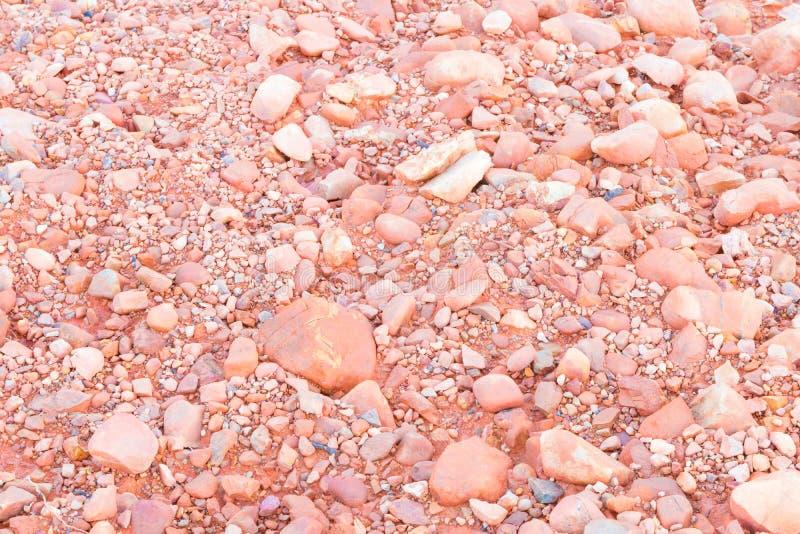 Stein masert orange Landhintergrund des Orangen- und Bodenbodens in der Natur für Hintergrund mit Kopienraum stockfoto