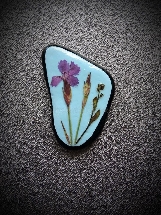 Stein mit gepresster Blume vektor abbildung