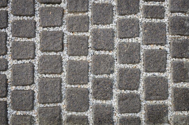 Steinbodenmuster mit weißem Kiesel lizenzfreie stockbilder