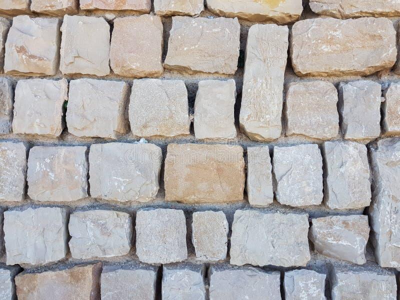 Steine fügten, zusammen einen Wandbeschaffenheitshintergrund zu schaffen stockfoto