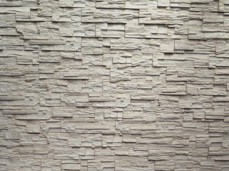 Steinfliesenbeschaffenheitsbacksteinmauer tauchte auf lizenzfreies stockfoto