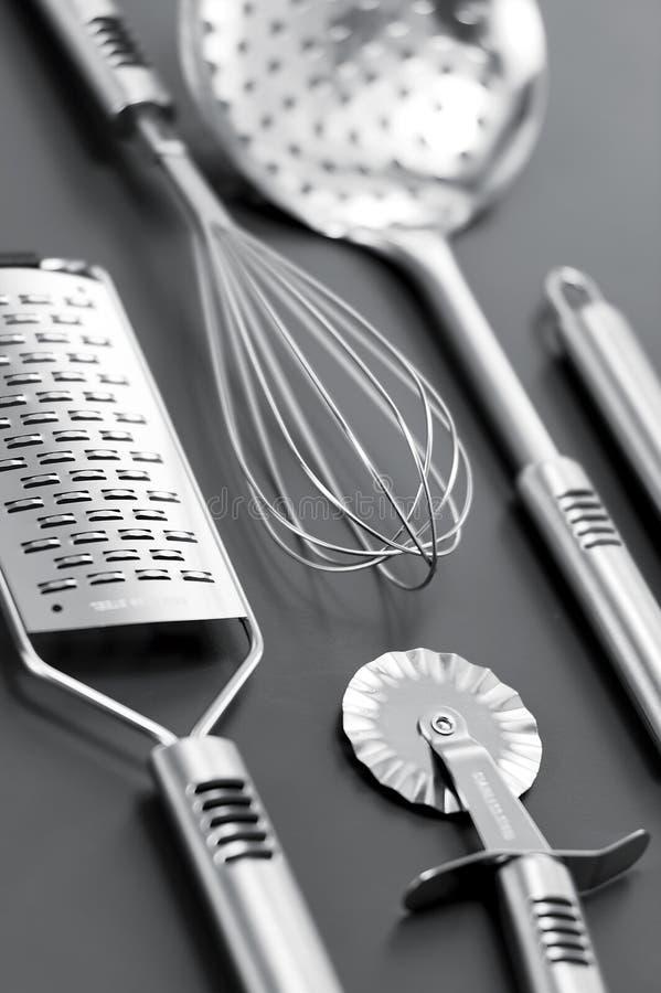 Steinless Kitchen Stuff On Gray Background Royalty Free Stock Photos