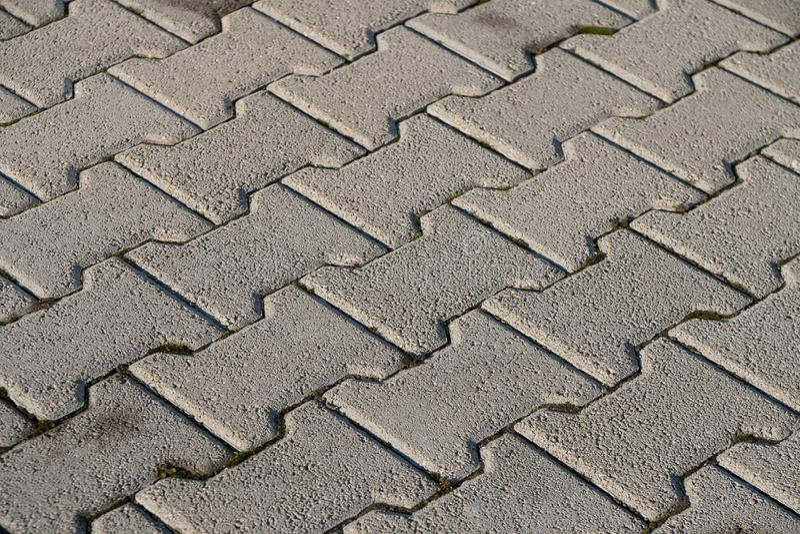 Steinpflasterungsbeschaffenheit Abstrakter Hintergrund alten Kopfsteins p lizenzfreies stockbild