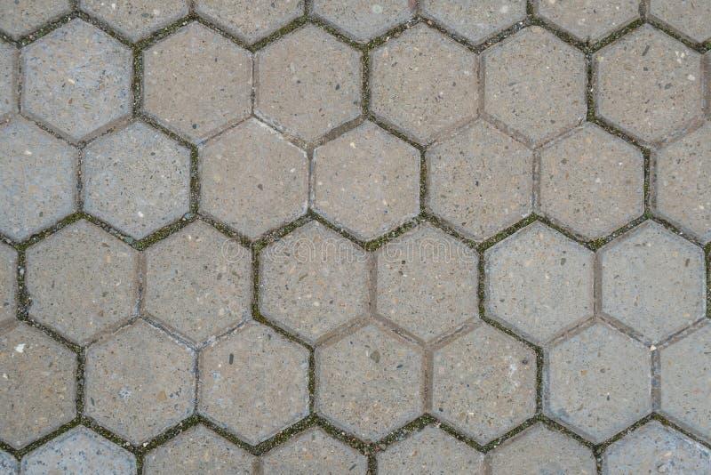 Steinpflasterungsbeschaffenheit Abstrakter Hintergrund alten Kopfsteins p lizenzfreies stockfoto