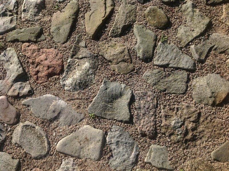 Steinpflasterungsbeschaffenheit, cobblestoned Pflasterungshintergrund des Granits stockbild