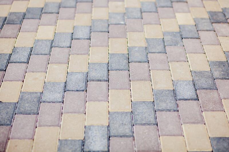 Steinpflasterungsbeschaffenheit Cobblestoned Plasterungshintergrund des Granits Abstrakter Hintergrund der alten Kopfsteinpflaste lizenzfreie stockfotografie