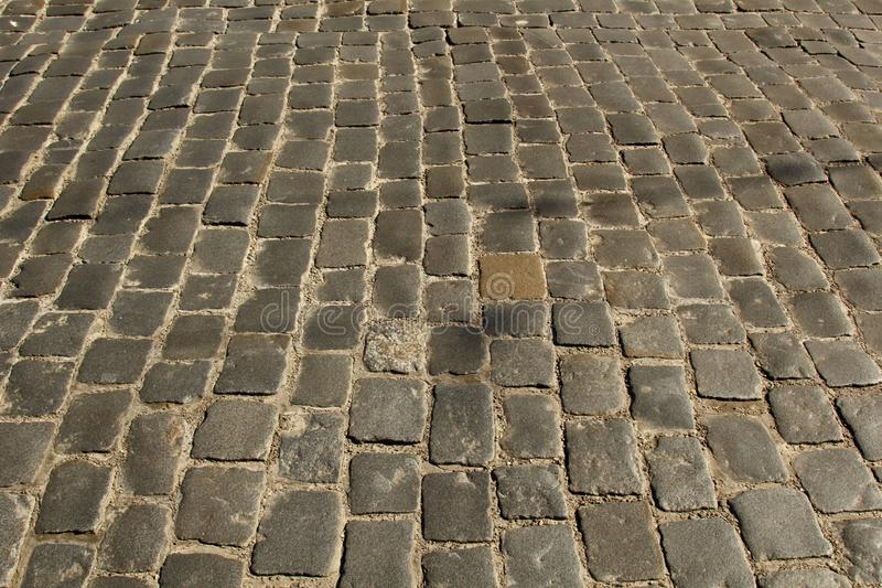 Steinpflasterungsbeschaffenheit Cobblestoned Plasterungshintergrund des Granits Abstrakter Hintergrund der alten Kopfsteinpflaste lizenzfreies stockbild